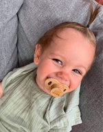 Happy Aaron with a bamboo pacifier