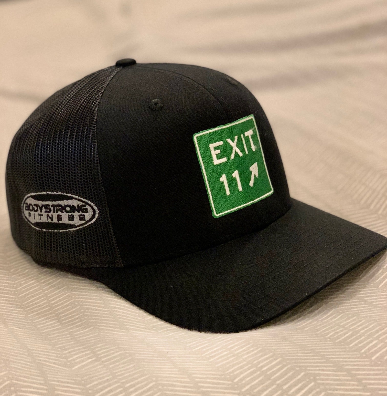 Black Richardson hat with the EXIT 11 sign on the fron and Bodystrong logo on the side