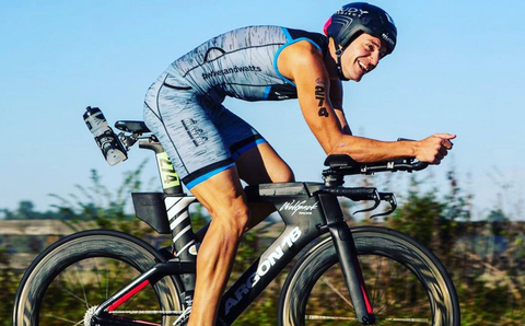 athlete on a bike wearing a pair of tri shorts