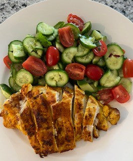 Air fried chicken breast with cucumber tomato salad and vanilla olive oil lime dressing