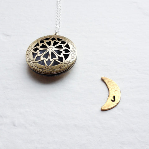initial locket with moon