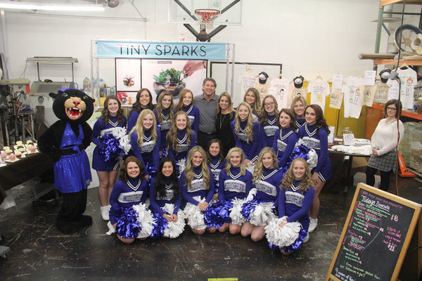 The Midlothian Cheer Team surrounded Brad Oldham and Christy Coltrin in workshop.