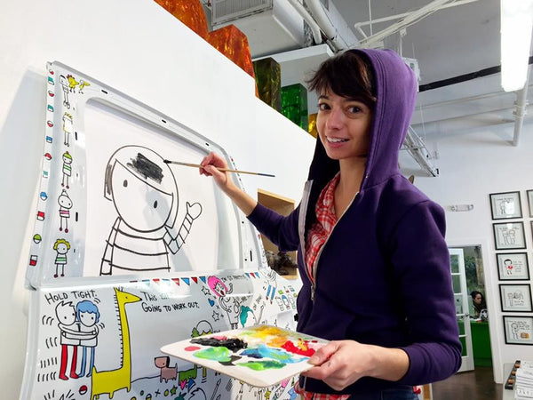 Kate Micucci putting the finishing touches on her original artwork before her art show at Brad Oldham Sculpture in Dallas.