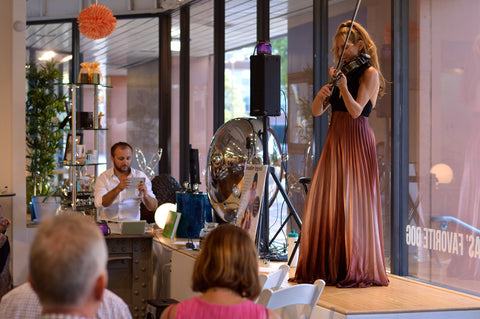 "Violinist-surfer-athlete Jennifer Argenti was the featured performer during the event. She played her violin and shared stories from her ""Giving Back Tour."" Brad Oldham Sculpture was the Dallas performance on her national tour."