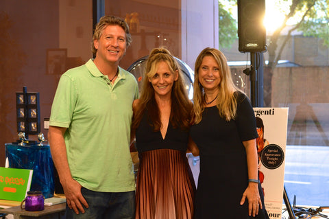 Hosts Brad Oldham and Christy Coltrin took a picture with Jennifer Argenti (center) after the concert.