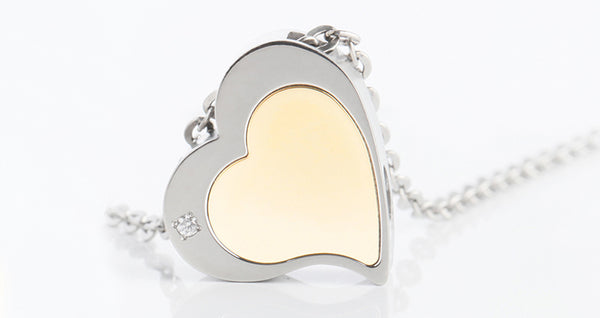 Embracing heart cremation urn necklace