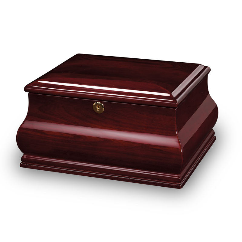 An elegantly curved, high-gloss rosewood finished chest and cremation urn.