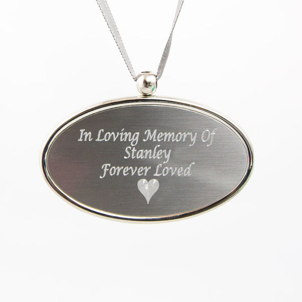 Engraved silver oval pendant is pewter plated brass. It can be placed around the lid of the cremation urn.