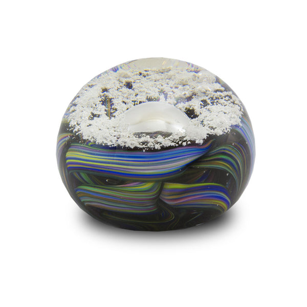 Paperweight created with a variety of colors as the ribbon. Ashes shown as bubbles.
