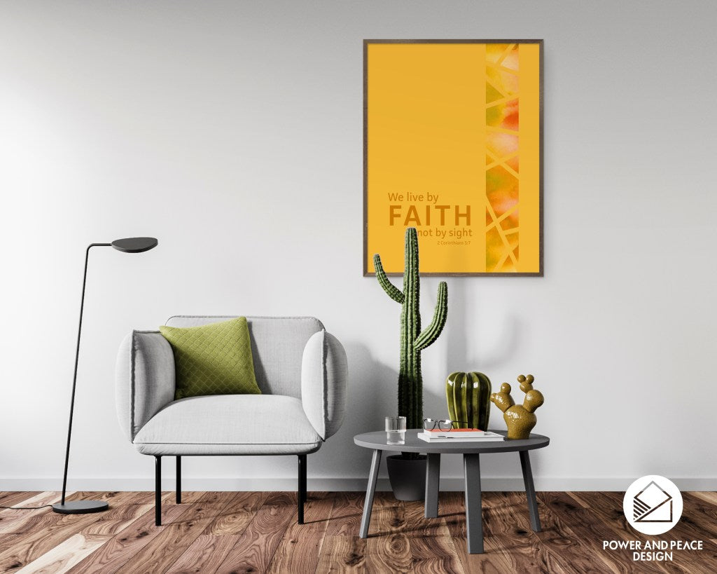 Mustard yellow Scripture art with 2 Corinthians 5:7 We live by faith, not by sight. Art is hanging in modern gray living room near gray chair.
