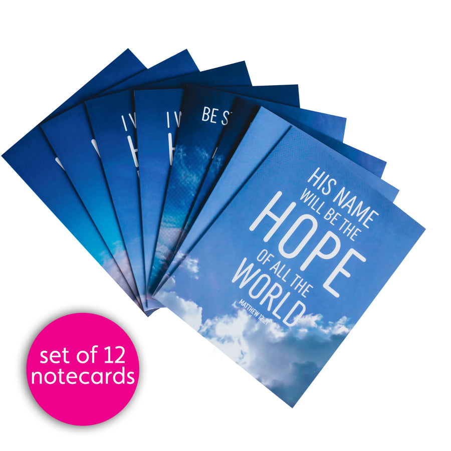 Fan of Bible verse notecards. All cards are blue with white text and feature photos of the sky. Top card reads His name will be the hope of all the world. Matthew 12:21. Pink circle reads