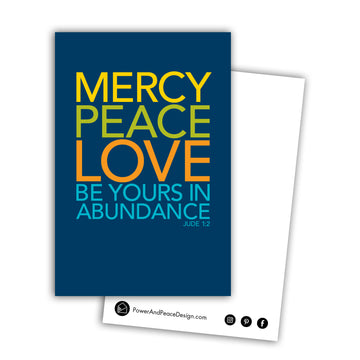 Bible postcard with the words Mercy, peace, love be yours in abundance Jude 1:2. Type is large and bold and all caps on a navy blue background. Words are in yellow, lime green, orange, and teal. Back of postcard is white with black Power and Peace Design logo and website.