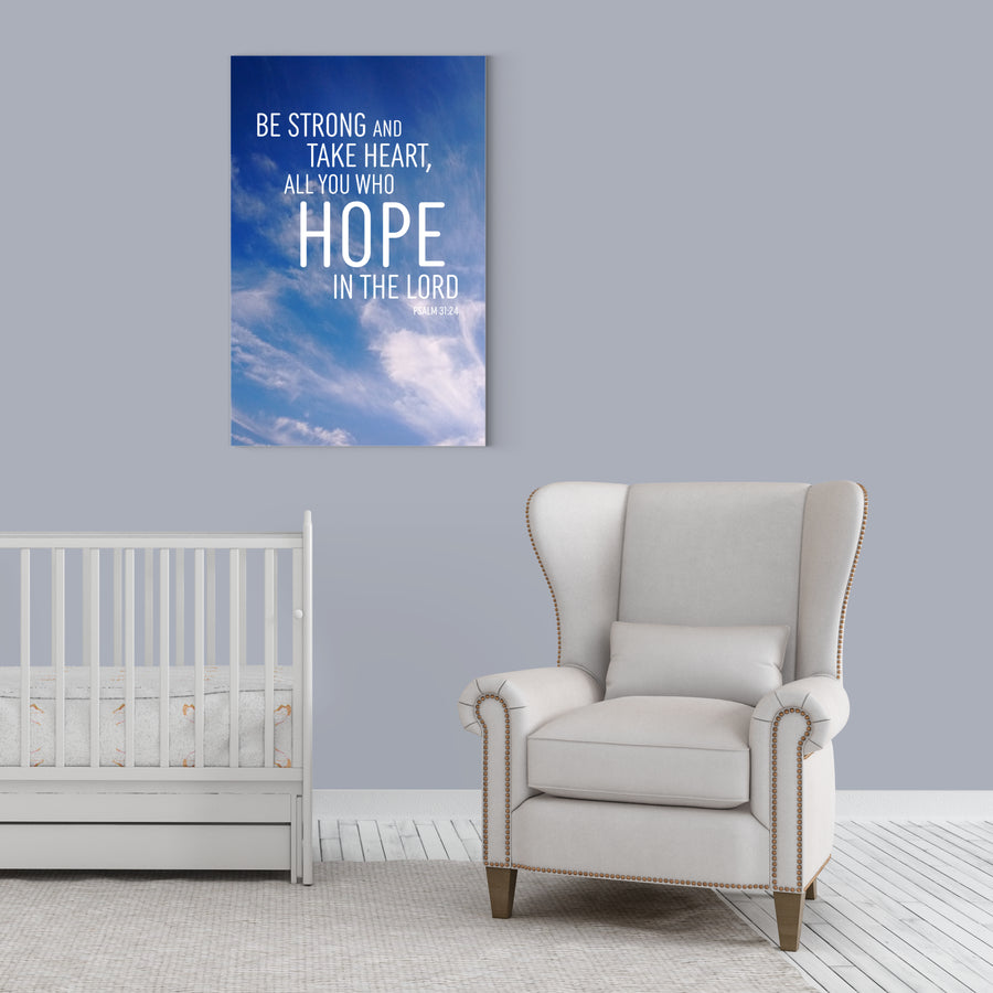 Nursery with light blue walls, white floor, white crib, white chair. Large canvas with a photo of the sky on the wall. Text on top of photo reads Be strong and take heart, all you who hope in the Lord. Psalm 31:24.