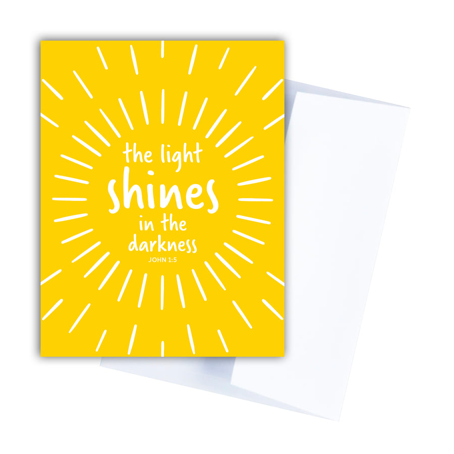 Yellow Scripture greeting card. White text centered in a ring of white lines reads