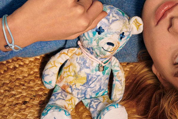 Louis Vuitton For UNICEF includes new color of silver Lockit and first teddy bear.