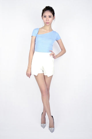 AUD ASYMMETRICAL KNIT TOP IN POWDER BLUE