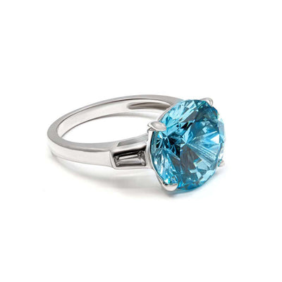 Anastasia 13 Ring Vivid Blue - Anna Zuckerman Luxury 6 carat round vibrant blue crystalline set in a classic baguette ring, for a total weight of 6.5 carats. Set in platinum plated sterling silver 925.