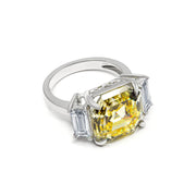 Arabella 04 Ring - Anna Zuckerman Luxury Ultimate classic 3 stone ring with a 9 carat center argyle pink crystalline stone and 2 carat side white emerald cut diamond crystalline for a total combined gem weight of 11 carats set in platinum plated sterling silver 925 #color_canary-yellow