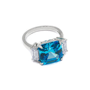 Arabella 04 Ring - Anna Zuckerman Luxury Ultimate classic 3 stone ring with a 9 carat center argyle pink crystalline stone and 2 carat side white emerald cut diamond crystalline for a total combined gem weight of 11 carats set in platinum plated sterling silver 925 #color_vivid-blue