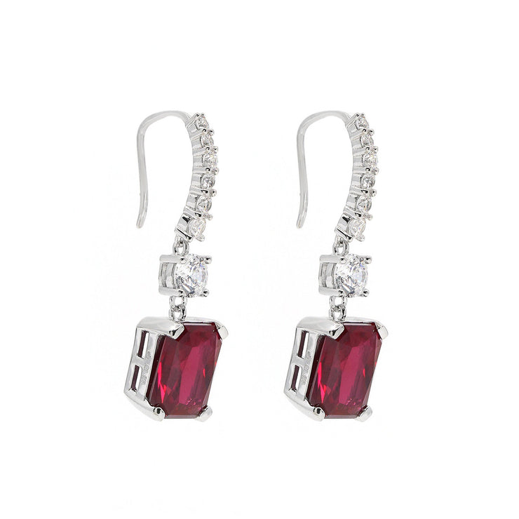 Exquisite earrings with 6 carats of radiant cut crystalline topped with dangling graduating line of diamond white crystallines set in platinum plated sterling silver 925