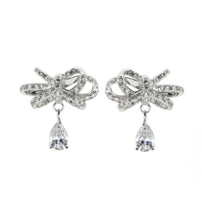 Ornate diamond white crystalline fillagree bow with pear drop, 3tcw, set in platinum plated sterling silver 925