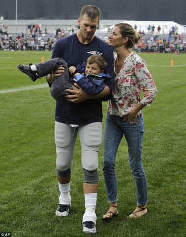 Tom and Gisele look adorable on the field together with their son