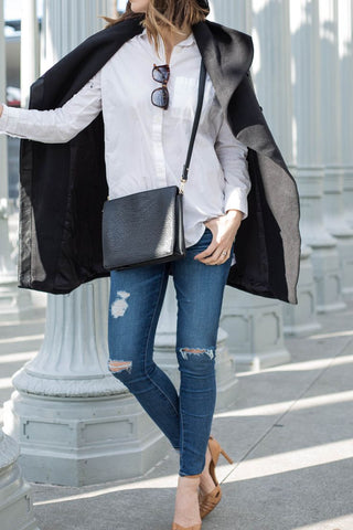 Fashion blogger Michelle Madsen wears distressed AG Jeans