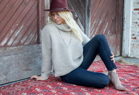 Laura Jean carries 360Sweater cashmere and Frye boots