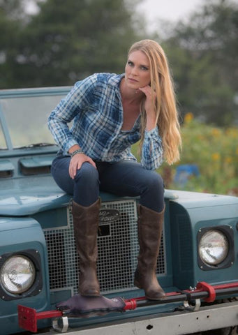 Model Gina Siebrandt strikes a pose on this vintage Land Rover at Sweet Berry Farm
