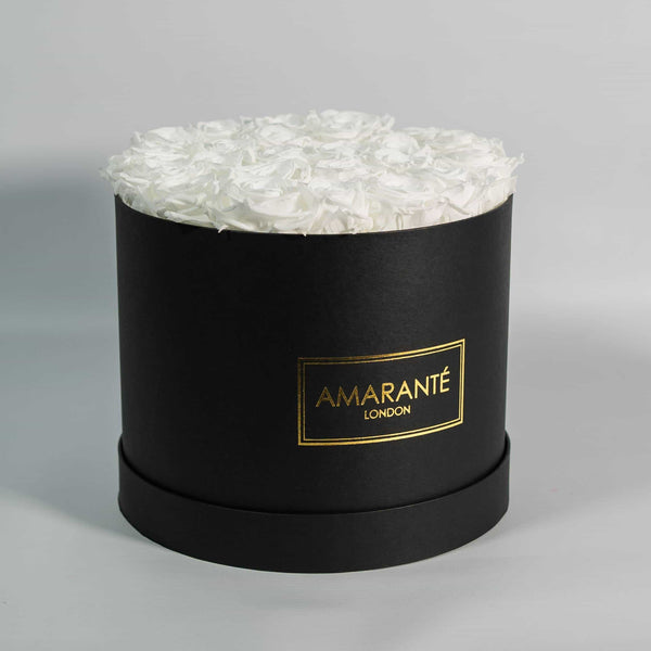 White roses that last forever in black round box