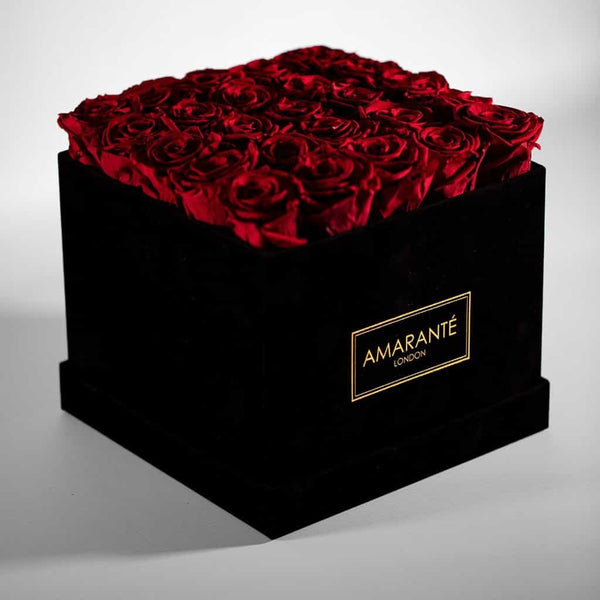 Red Infinity roses in a hatbox, elegant square shape in black suede