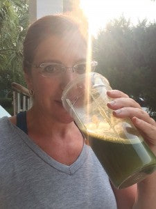 Dr. Anna drinking healthy green drink