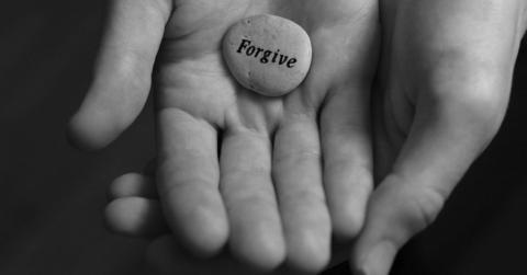 Hands-with-forgive-stone