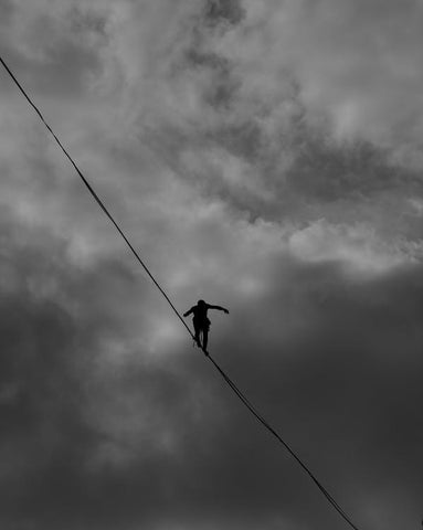A person balancing on a rope