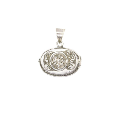 silver gau with dharma wheel