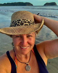 A picture of Sheila the owner of Sexessories, an adult store in Parksville, BC on Vancouver Island - she is at the beach