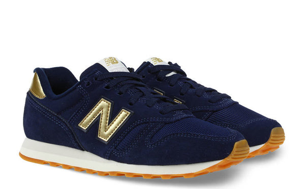 NEW BALANCE 373 DONKERBLAUW/GOUD DAMES