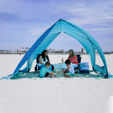 Load image into Gallery viewer, A Shade tent comfortably accommodates two women and two children sitting on the beach.