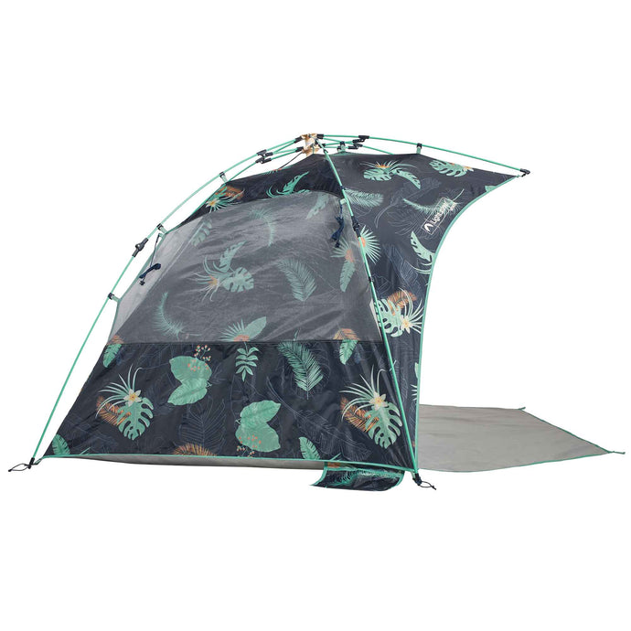 Side view of Deep Tropics Sun Shelter beach tent in dark blue with green and orange tropical print.