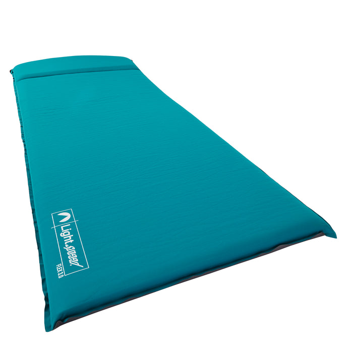 Teal color PVC-free 3 inch thick sleep pad. Features integrated pillow, foam top and soft FlexForm material.