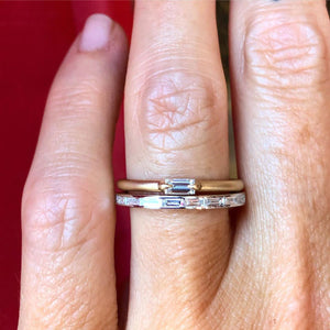 skinny wedding band on finger