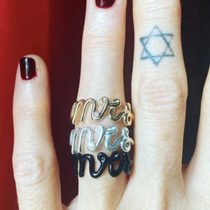 Mrs script rings on finger
