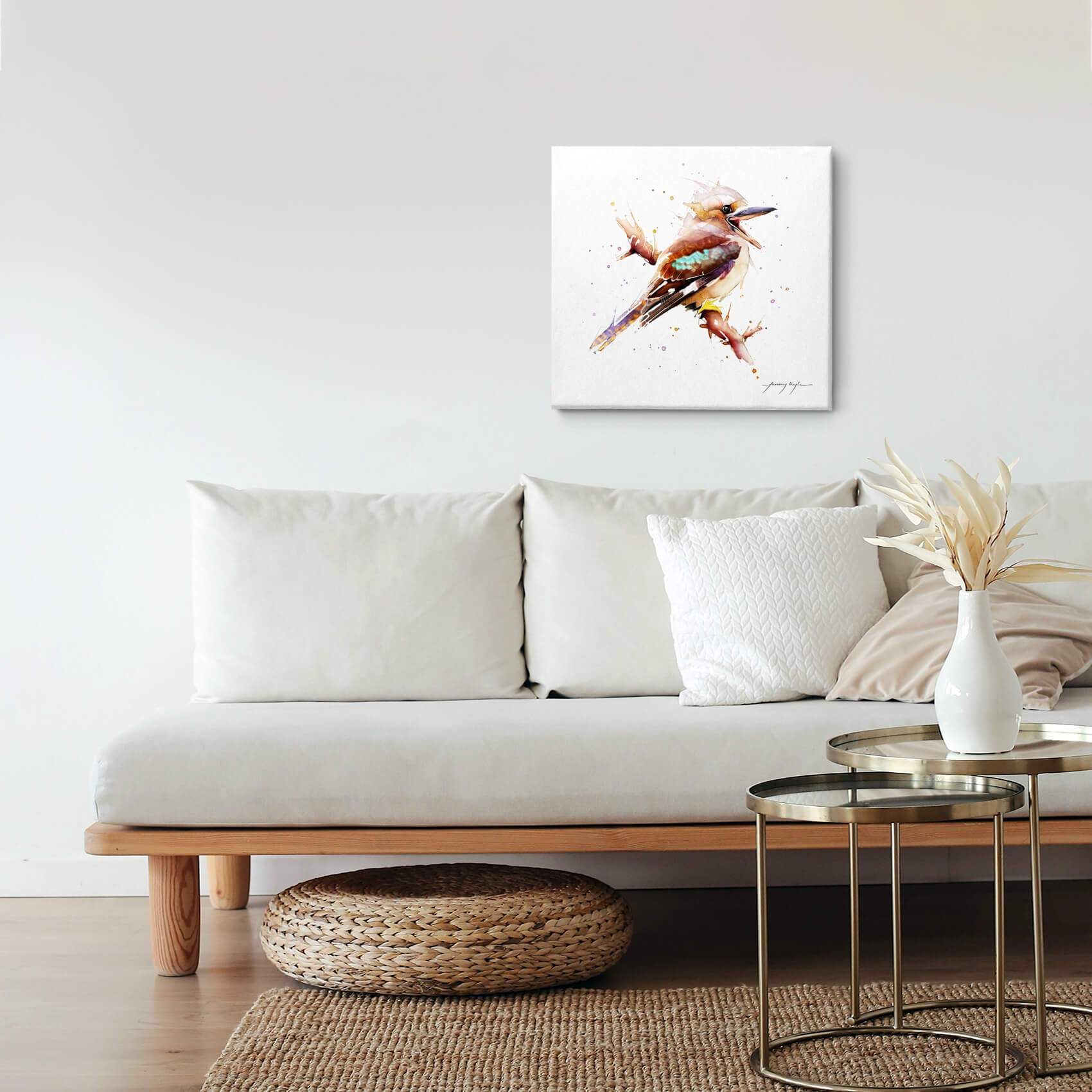 Kookaburra bird canvas wall art hanging in a living room.
