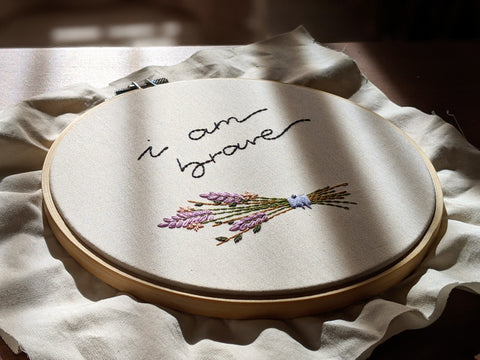 I am brave quote and flower bouquet embroidered on natural cotton