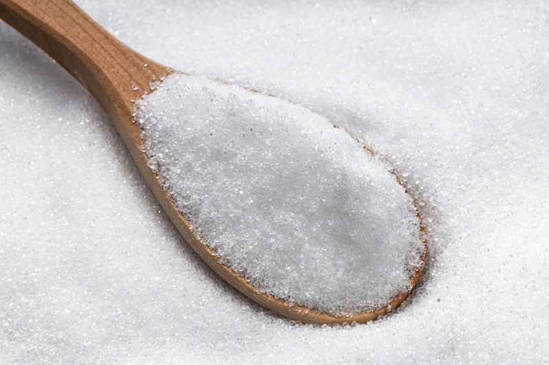 wooden spoon with erythritol