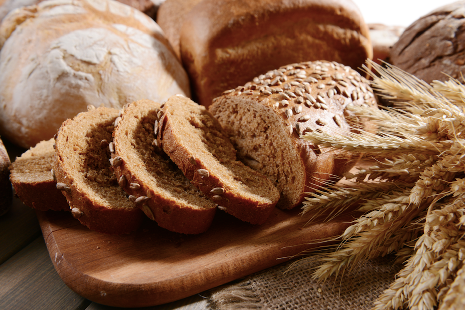 assorted bread on a wooden table