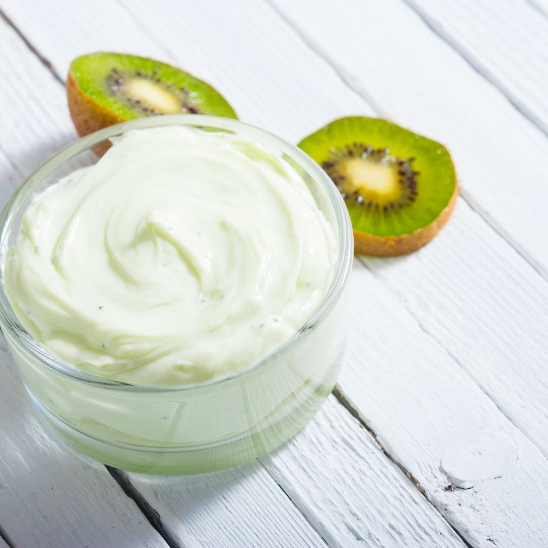 sliced kiwi with face cream photo