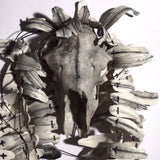 Feather_boa_with_sheep_skull_jewellery