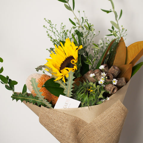 lil bouquet with sunflowers and gumnuts for our Bare Bomb giveaway in West End