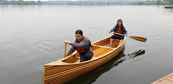 Paddling the finished cedar strip canoe